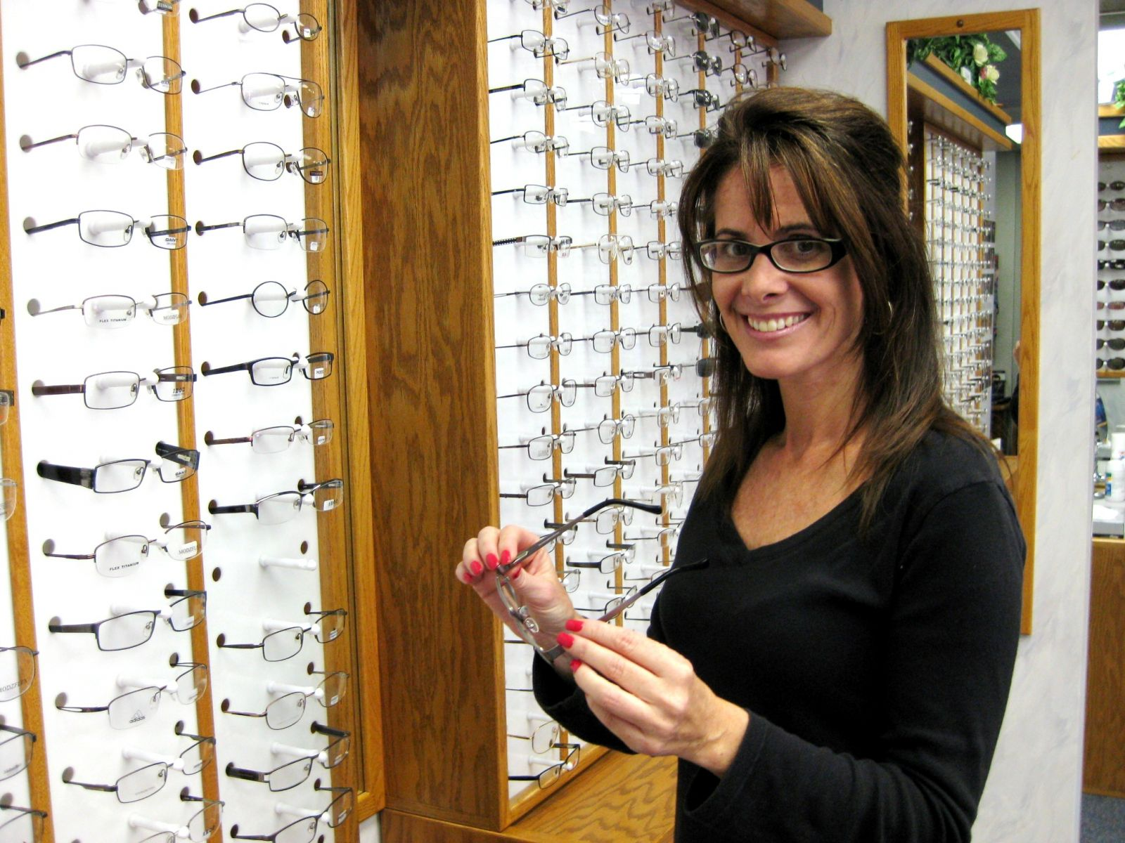 Woman Picking Out Frames